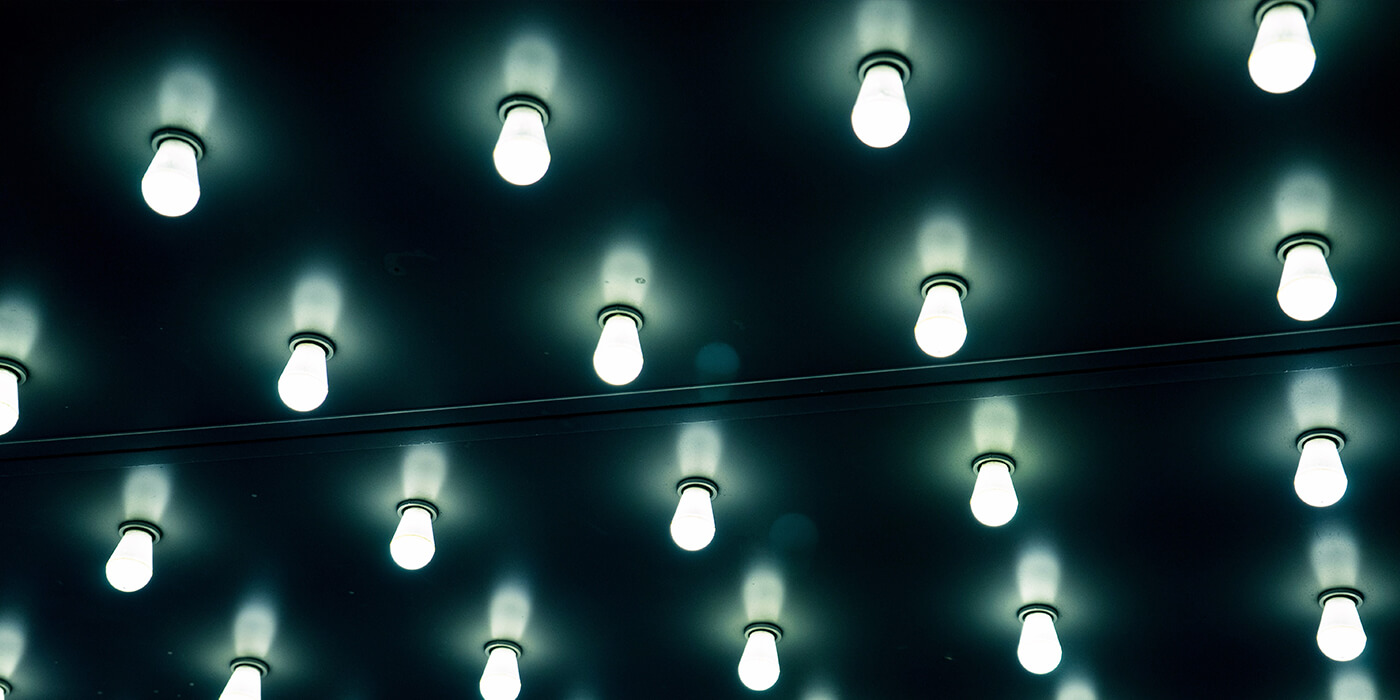 Lots of light bulbs on a dark ceiling