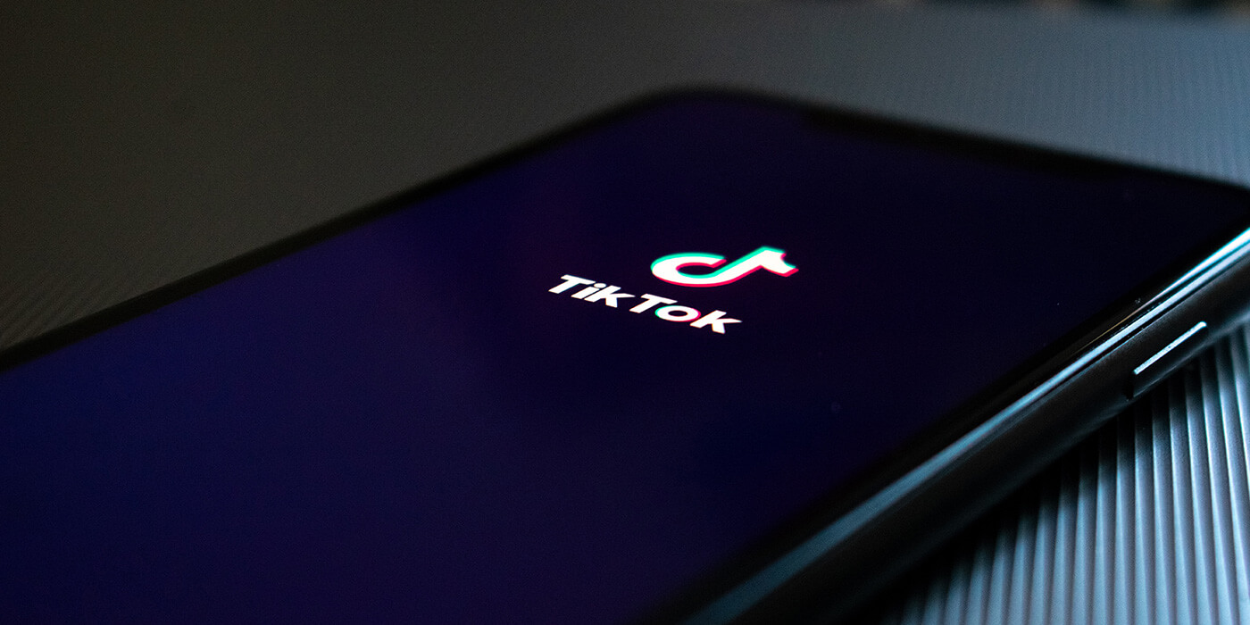 TikTok logo displayed on a mobile phone